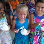Children eating vanilla ice cream