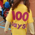 Young child wearing a 100 Days t-shirt