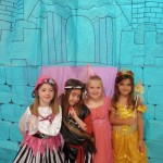 Children dressed as both pirates and princesses with a castle background they made